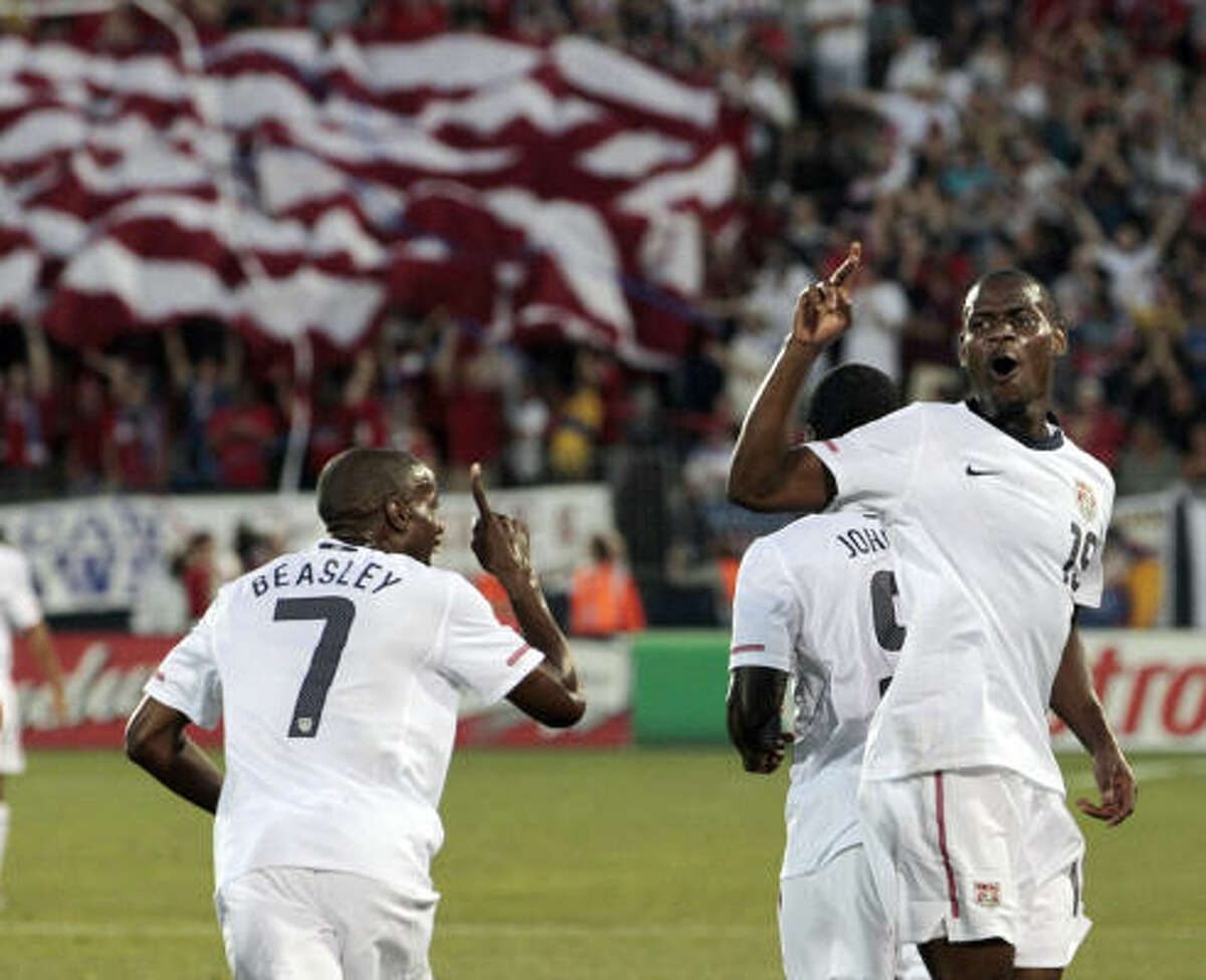United States' Maurice Edu, right, celebrates his goal against the Czech Republic with teammate DaMarcus Beasley during the first half.