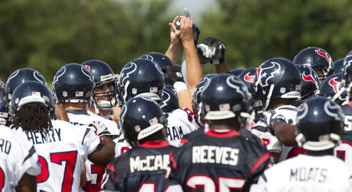 The Texans gather together at the beginning of Tuesday's organized team activities.