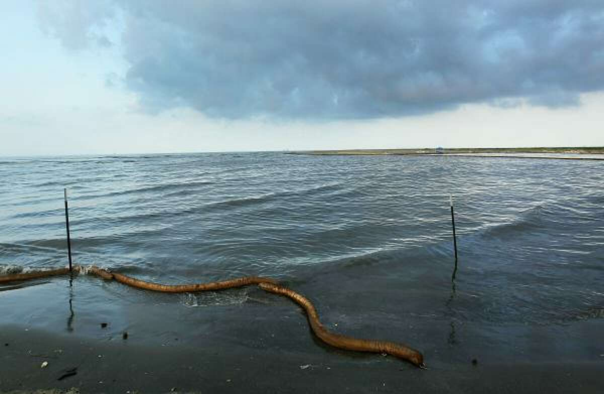 A broken oil boom snakes through the water on a beach on May 25, 2010 at Elmer's Island, La. Cleanup crews had worked for days trying to remove oil from beach. As BP prepares to try and stop the oil leak with a