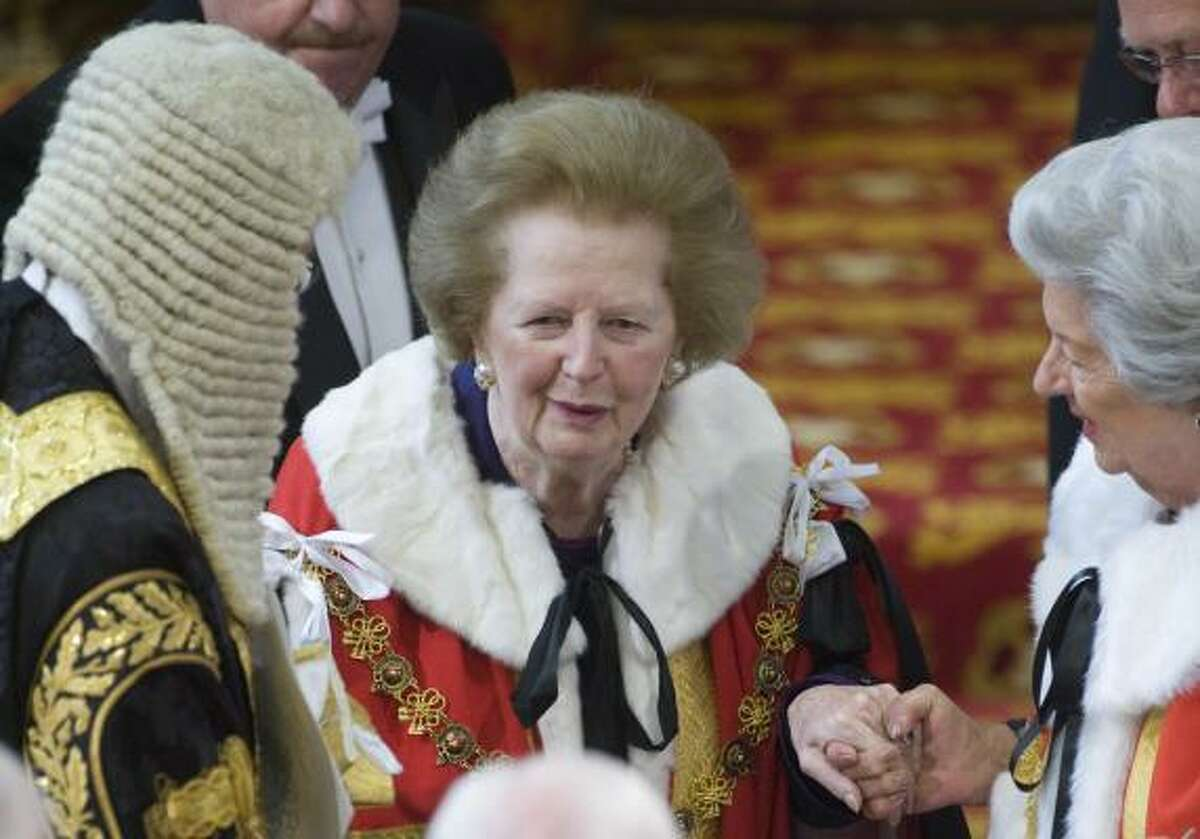 Former British Prime Minister Margaret Thatcher is assisted in the House of Lord's during the State Opening of Parliament at the Palace of Westminster, London Tuesday May 25, 2010.