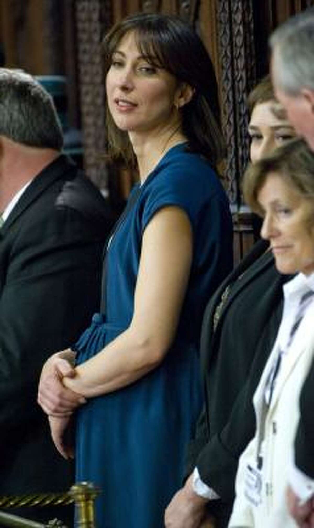 Samantha Cameron, center, wife of Britain's Prime Minister David Cameron, stands in the House of Lords during the State Opening of Parliament at the Palace of Westminster, London Tuesday May 25, 2010.