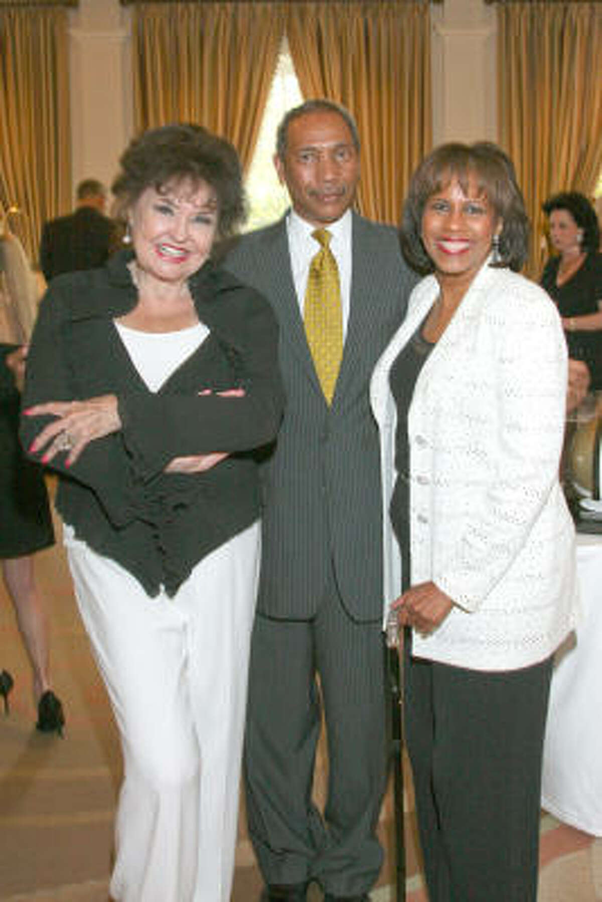 Emcee Warner Roberts with John Guess Jr. and honorary chair Melanie Lawson