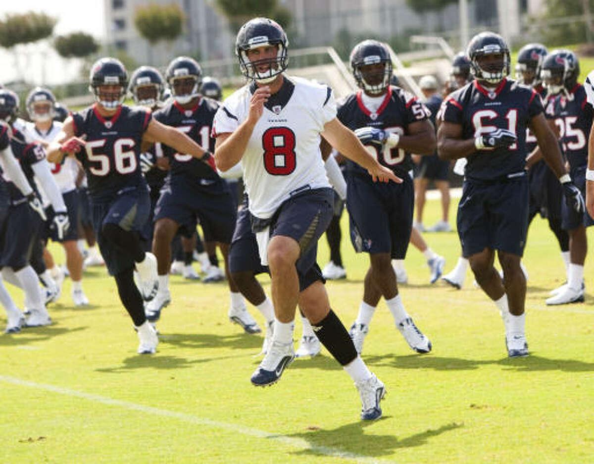 Quarterback Matt Schaub (8) leads the Texans through warmups during Monday's organized team activities.