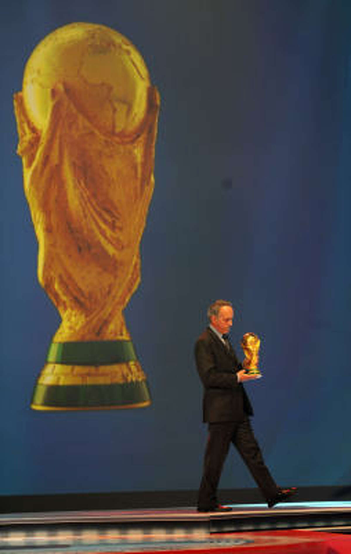 Giancarlo Abete, president of the Italian Federation holds the World Cup during the final draw.