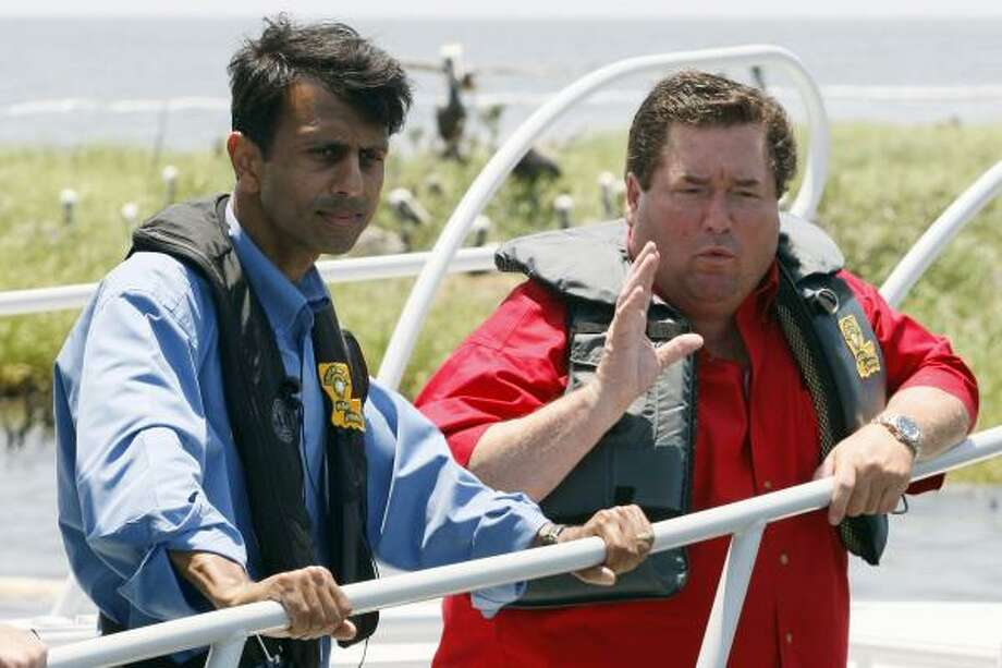 Louisiana Gov. Bobby Jindal, left, and Plaquemines Parish President Billy Nungesser speak while sailing near an island in Barataria Bay on the coast of Louisiana, Sunday, May 23, 2010. Photo: Patrick Semansky, AP