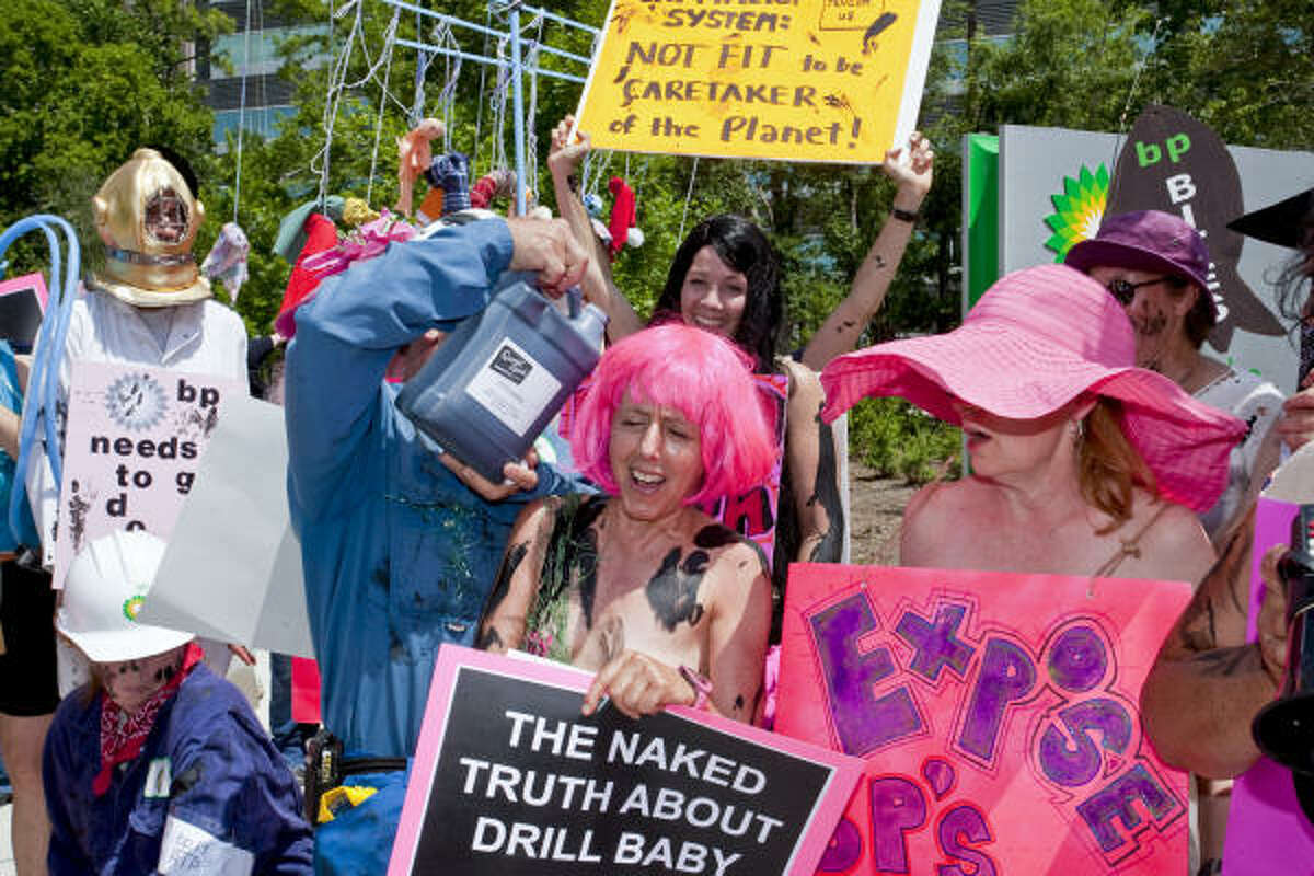 Medea Benjamin, co-founder of the Code Pink anti-war group, center, leads a demonstration outside the U.S. headquarters of BP Plc in Houston on Monday, May 24, 2010.
