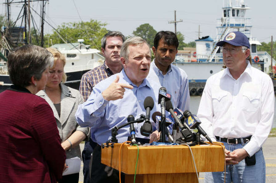 Sen. Dick Durbin, D-Ill., center, speaks at a press conference in Galliano, La., Monday, May 24, 201