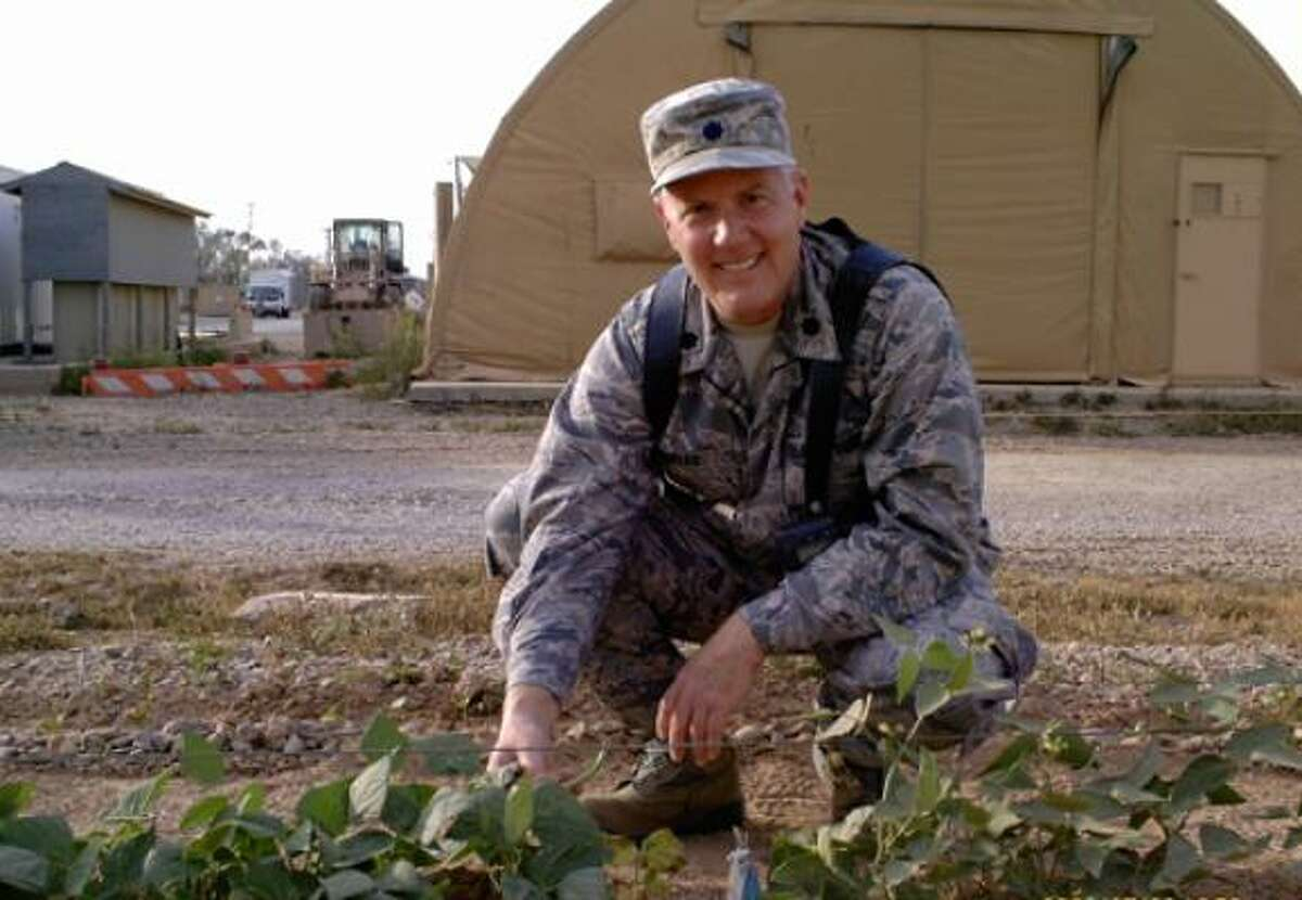 Lt. Col. Donal Dunbar harvests beans this spring in the large vegetable garden he and fellow gardeners planted at Joint Base Balad, Iraq. Read the story | Garden journal | Submit your garden photos | Houston Plant Database | HoustonGrows.com