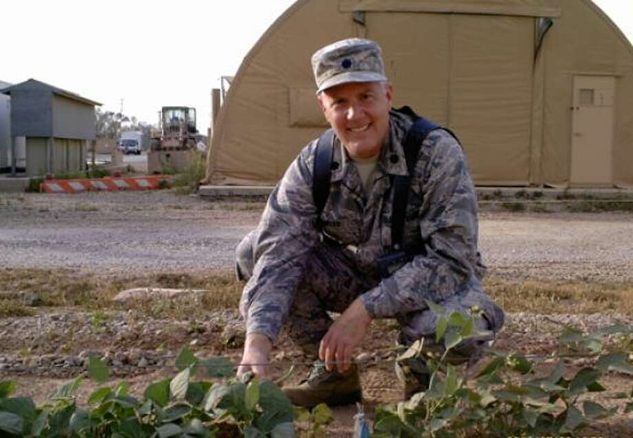 Lt. Col. Donal Dunbar harvests beans this spring in the large vegetable garden he and fellow gardeners planted at Joint Base Balad, Iraq. Read the story | Garden journal | Submit your garden photos | Houston Plant Database | HoustonGrows.com Photo: Courtesy Photo