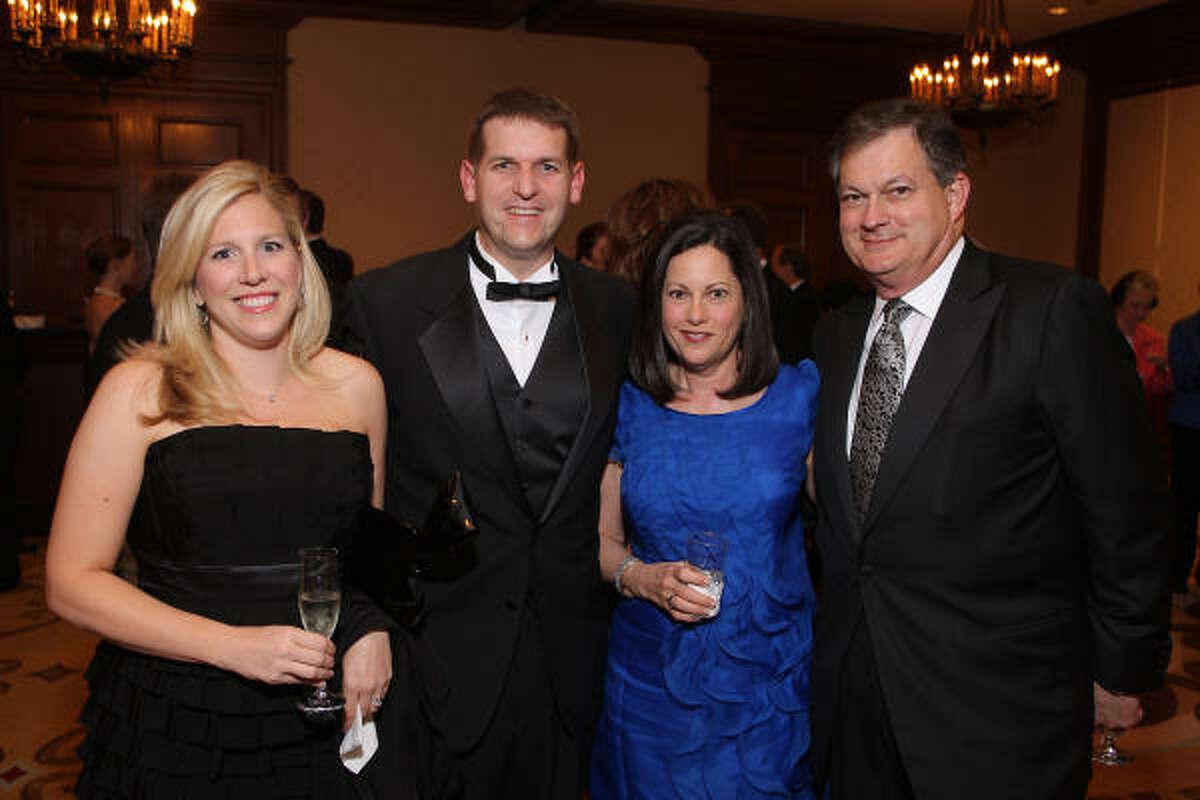 Alicia Raymond, Houston Area Women's Center Board Chair Shawn Raymond, honoree Sherry Merfish and Gerald Merfish