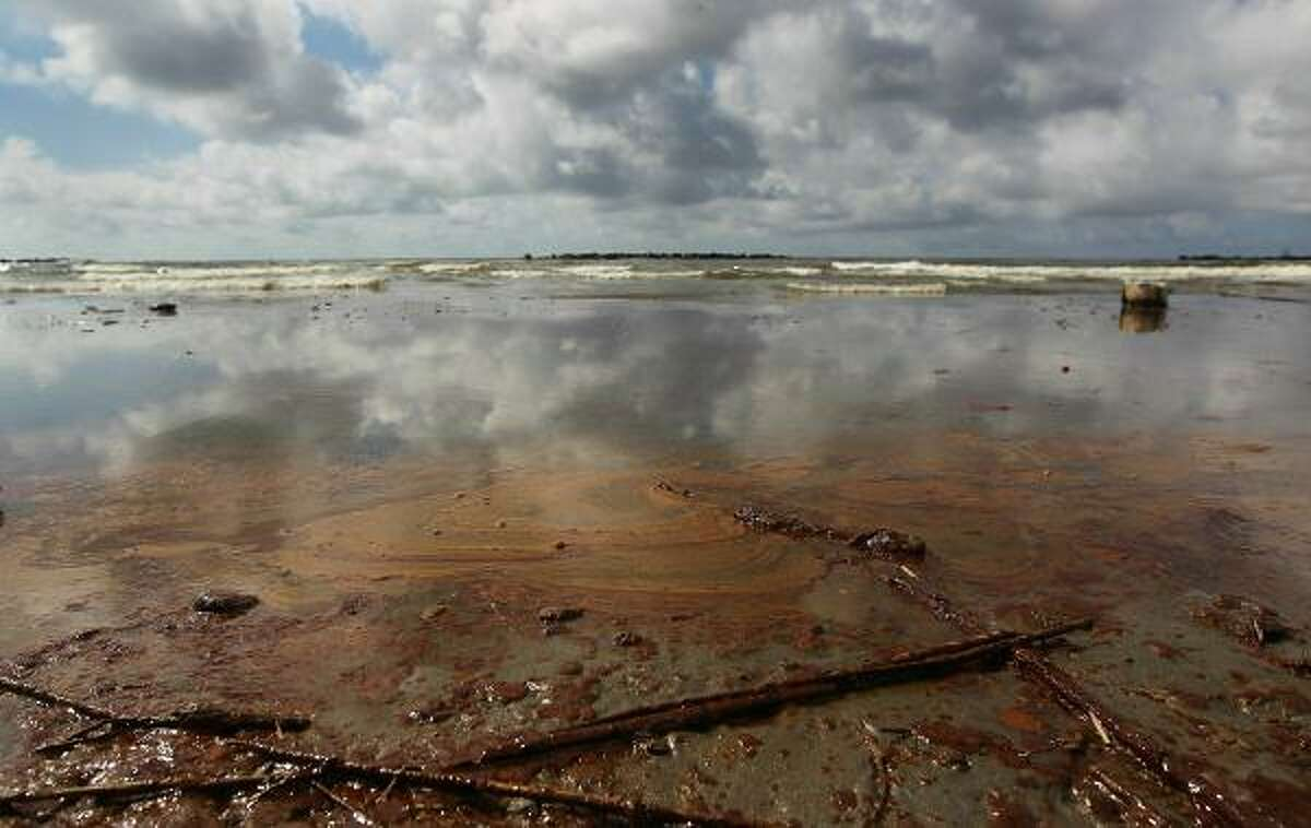 Oil from the BP leak in the Gulf of Mexico washes onto a beach in Grand Isle, La.