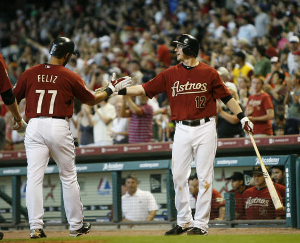 May 23: Rays 10, Astros 6 Feliz Pedro, left, high-fives Tommy Manzella after hitting the 1,000th home run (a three-run shot) by an Astro in the 10-year history of Minute Maid Park. The homer gave the Astros a 4-0 lead in the first inning of Sunday's game, but they were unable to maintain it.