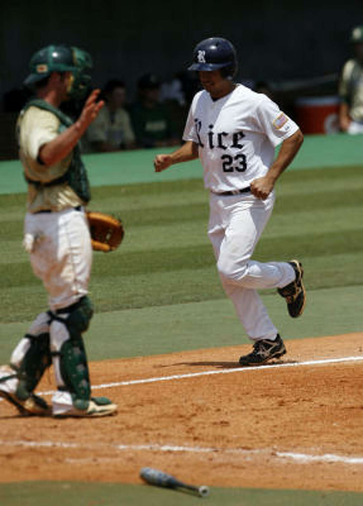 Rice's Anthony Rendon scores a run on a sacrifice fly hit by Michael Fuda in the sixth inning.