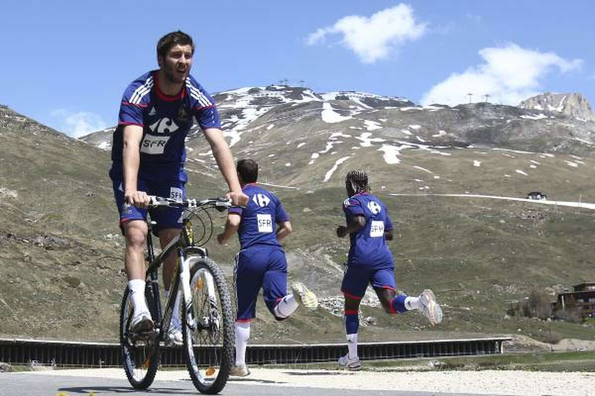 France soccer player Andre Pierre Gignac, left, rides a mountain bike during a training session in the French Alps resort of Tignes as part of their altitude preparation.