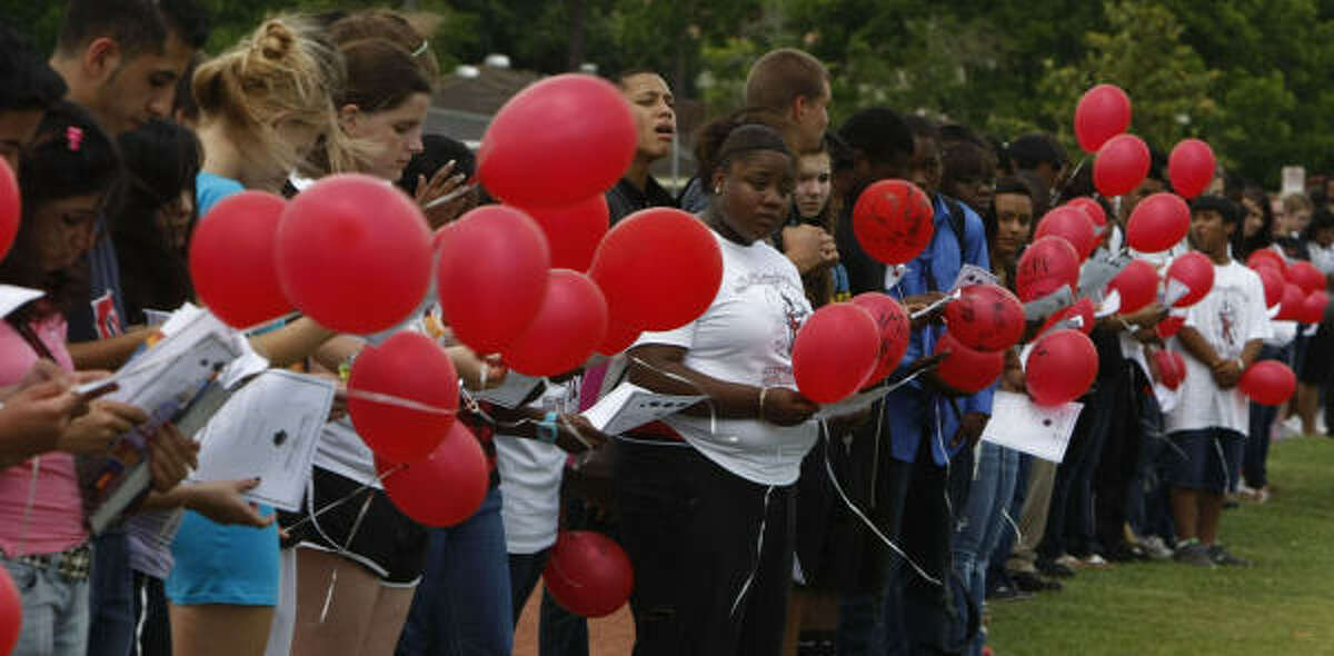 Bellaire High School students are seen on the track of the school with red balloons they released in remembrance of fellow student Tobi Oyedeji's birthda in Houston. Oyedeji died in a car accident on his way home from Prom.