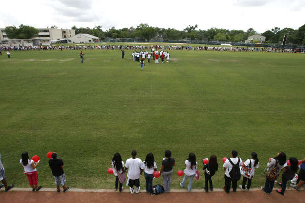 Bellaire High School students are seen on the track of the school with red balloons they released in remembrance of fellow student Tobi Oyedeji.