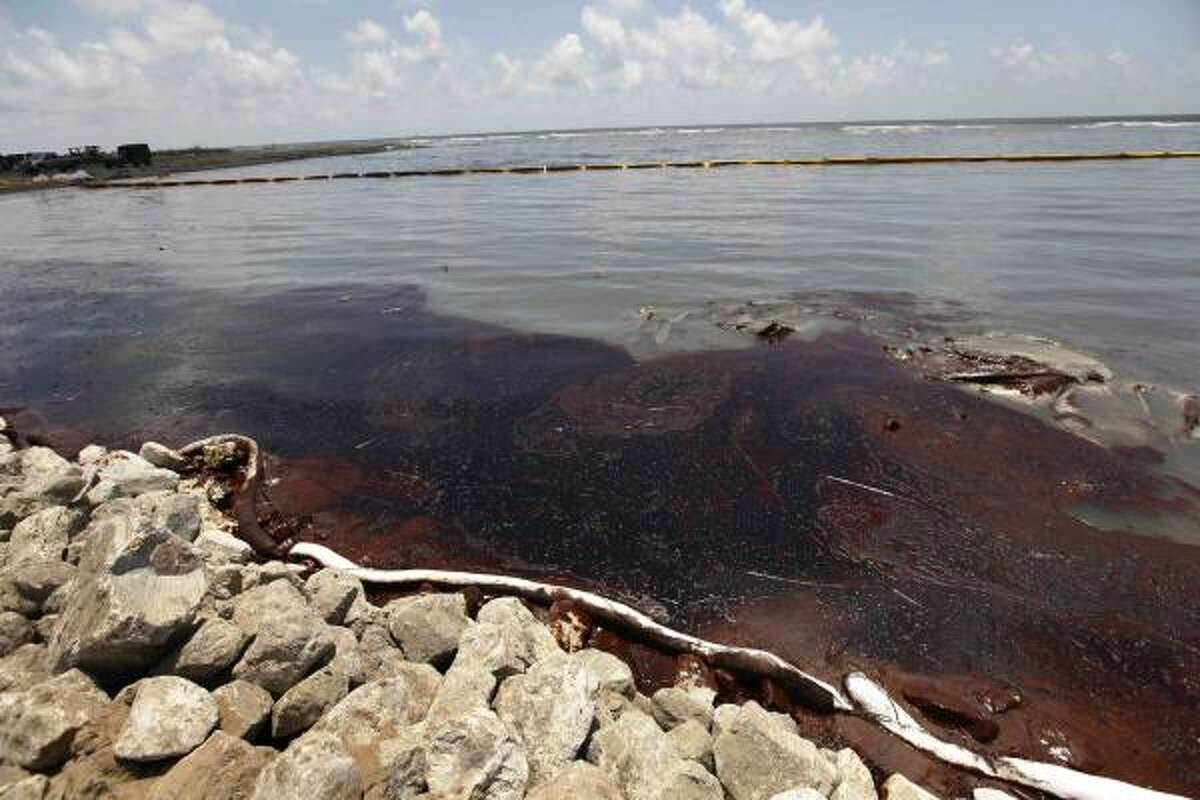 Oil from the Deepwater Horizon accident that got past a boom washes against a land bridge in Grand Isle, La., that was built to hold back the spill.