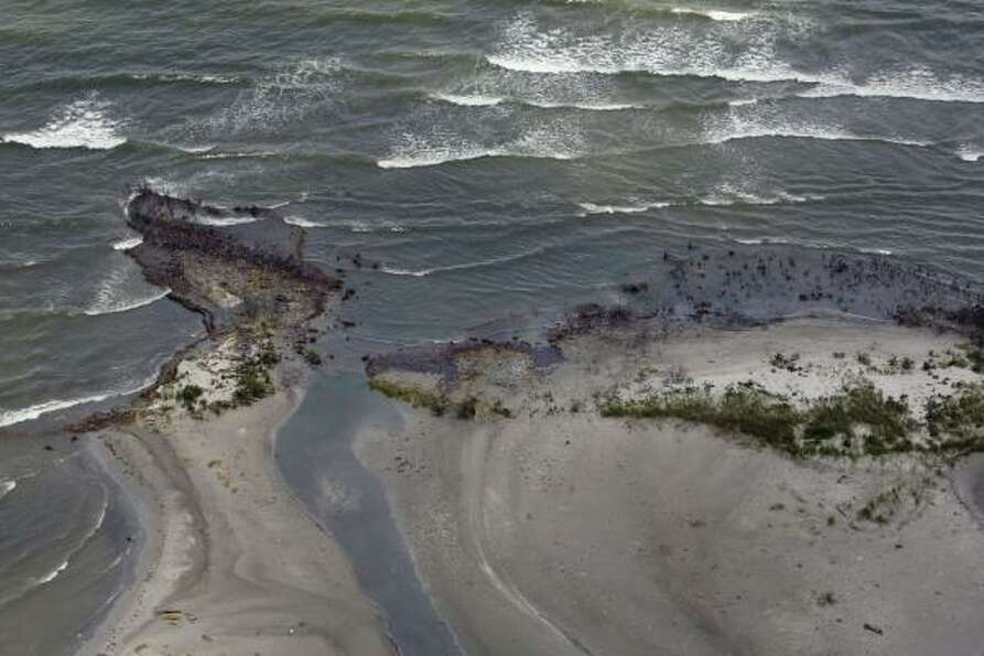 Oil from the Deepwater Horizon accident washes up along the coast of Louisiana between Cocodrie and