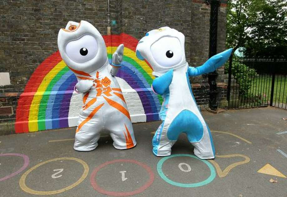 2012 OLYMPICS, PARALYMPICS The Olympic mascot Wenlock, left, and the Paralympic mascot Mandeville are unveiled to the media as the mascots for London 2012 on Wednesday, May 19. The theme of the two mascots is that they were created from the last drops of steel left over from the construction of the final support girder for the Olympic Stadium. The one-eyed monsters are sure to be the object of much derision. Photo: Julian Finney, Getty Images