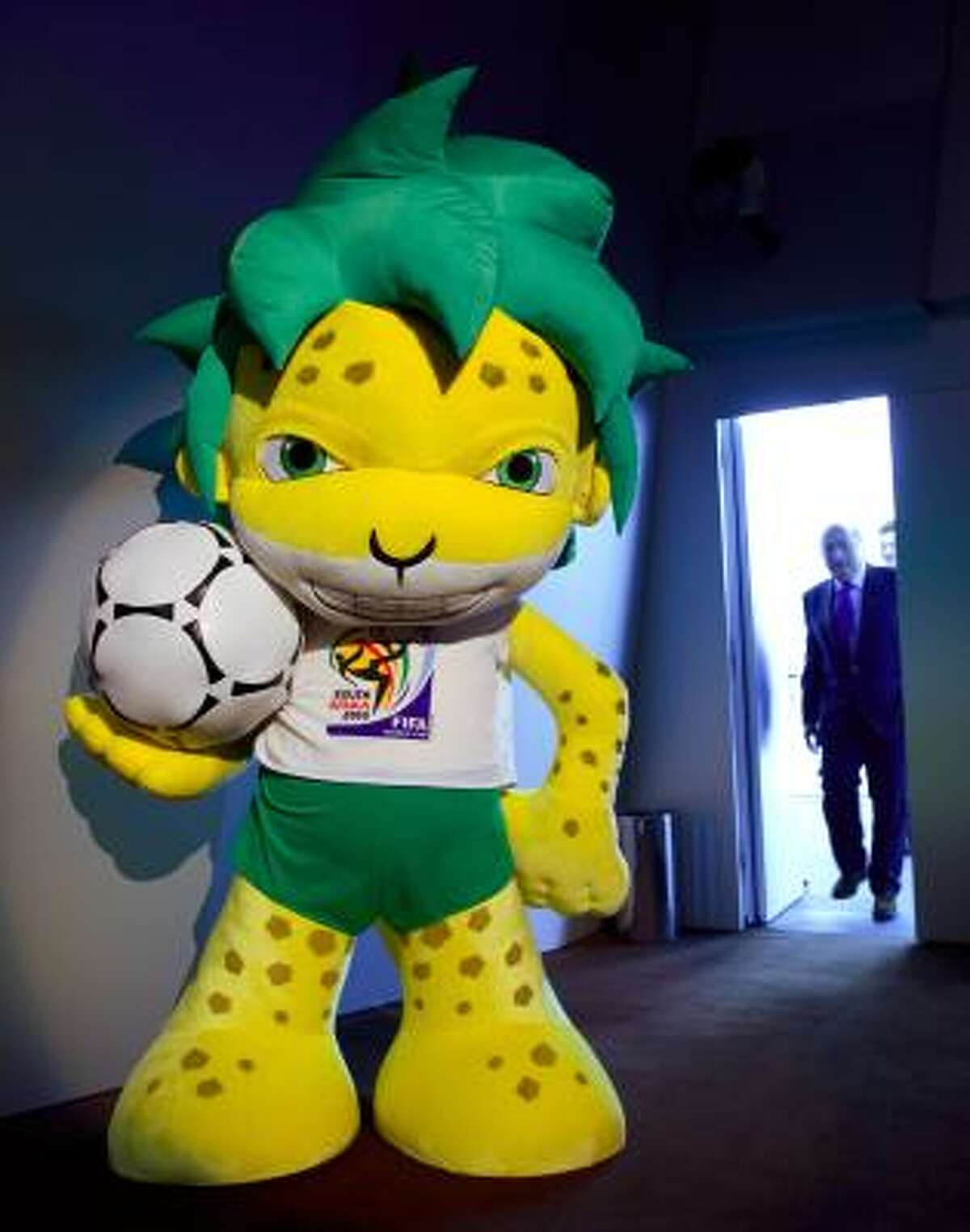2010 WORLD CUP Zakumi, the FIFA 2010 World Cup mascot, is supposed to be a leopard. Really? He looks more like a lion who lived a little too close to the nuclear power plant.