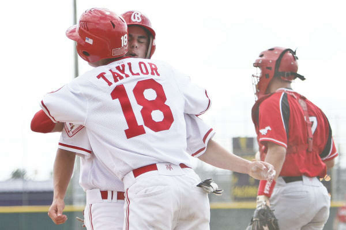 Bellaire's Aaron Hafer gets a hug from teammate Kirby Taylor (18) after they both scored on a two-run double by Toller Boardman.