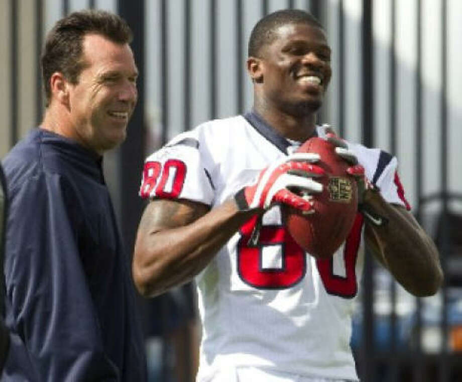 All-Pro wide receiver Andre Johnson reported for voluntary organized team activities Thursday after missing three days because he was unhappy with his contract. Photo: Brett Coomer, Chronicle