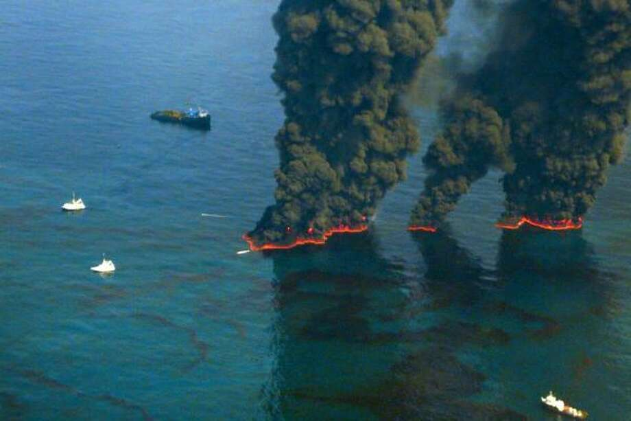 Crews conduct overflights of controlled burns taking place in the Gulf of Mexico to contain oil spewing from BP's Macondo well. Photo: John Kepsimelis/U.S. Coast Guard, Via Bloomberg