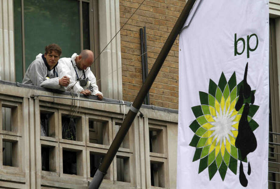 "Protesters from Greenpeace climbed on the balcony at BP's London headquarters and attached a flag with the company's logo altered to include oil splotches and the words ""British Polluters."" Photo: Lefteris Pitarakis, AP"