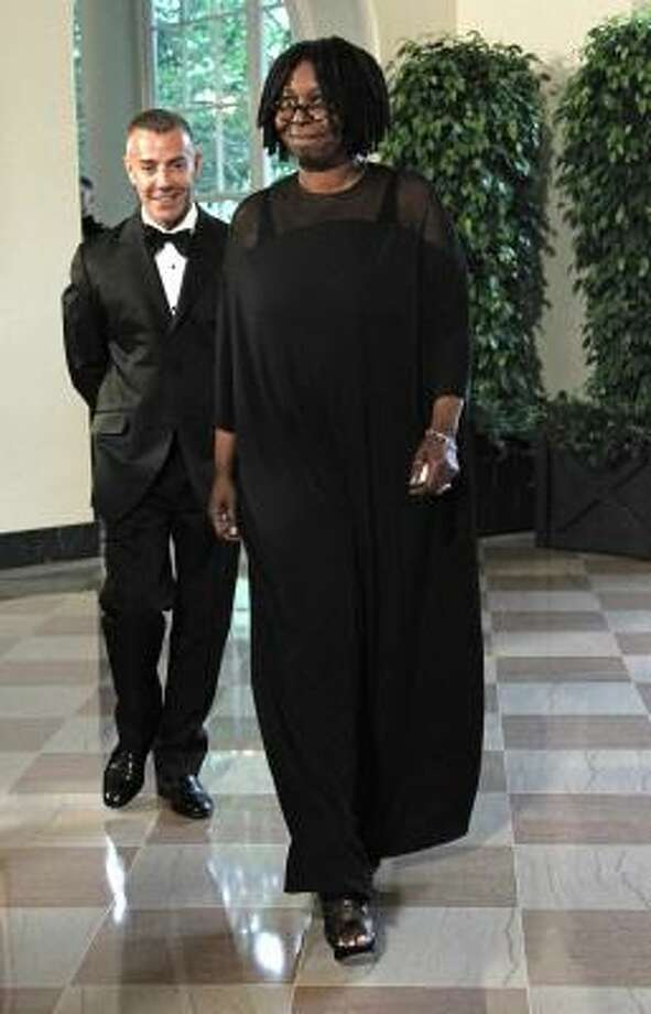 Entertainer Whoopi Goldberg and Thomas Leonardis arrive for the State Dinner in honor of Mexican President Felipe Calderon. Photo: Haraz N. Ghanbari, AP