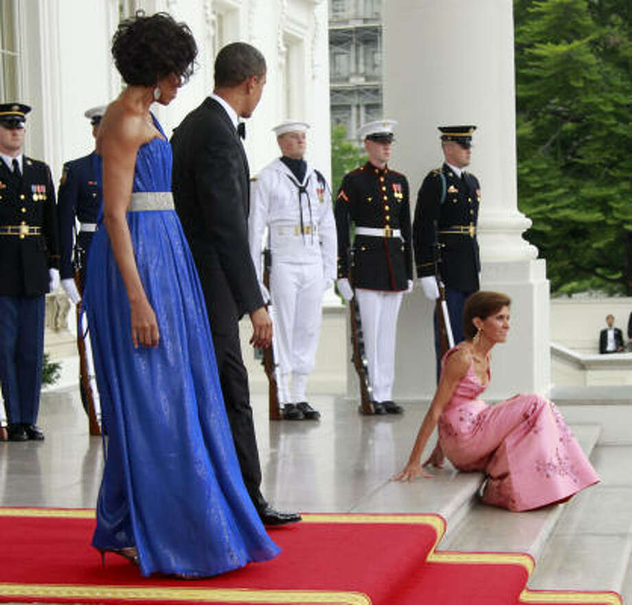 President Obama and first lady Michelle Obama watch as Chief of Protocol of the United States Capricia Penavic Marshall, right, slips on the steps before the arrival of Mexican President Felipe Calderon. Photo: Charles Dharapak, AP