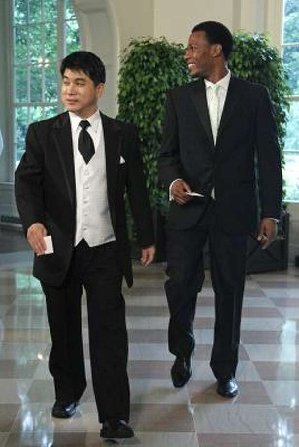 Olympic speedskater Shani Davis, right, and Jae Su Chun arrive for the State Dinner. Photo: Haraz N. Ghanbari, AP