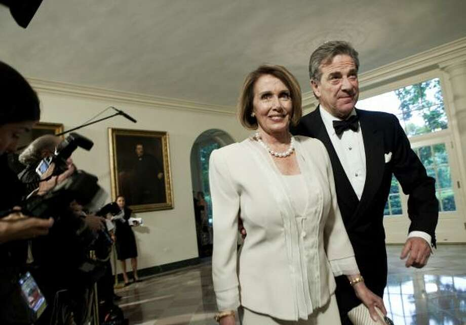 Speaker of the House Nancy Pelosi and husband Paul Pelosi arrive at the White House. Photo: Brendan Smialowski, Getty Images