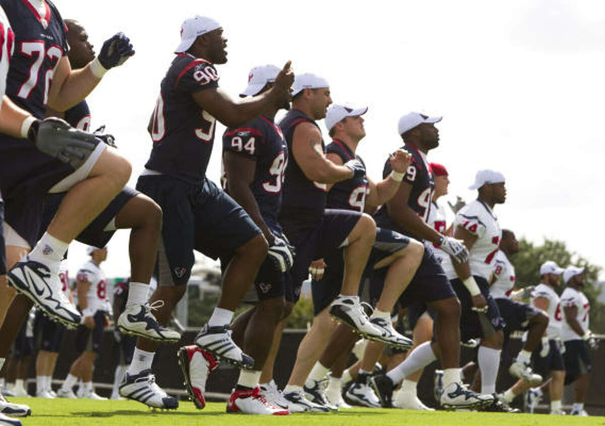 Texans players go through stretching drills prior to the start of Wednesday's organized team activities.