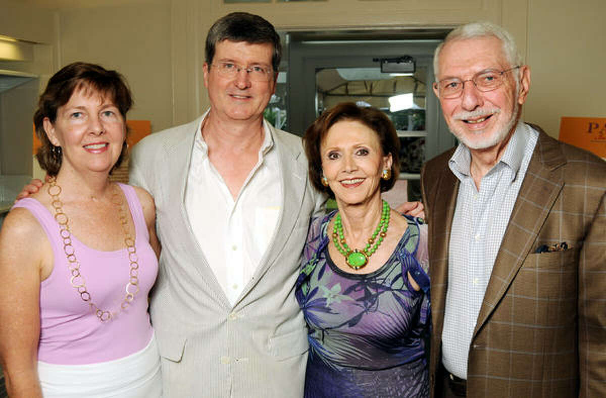 From left: Susan Clayton Garwood and George Peterkin with Cyvia and Melvyn Wolff at the Houston Public Library Foundation's Party in the Stacks at the Clayton House.