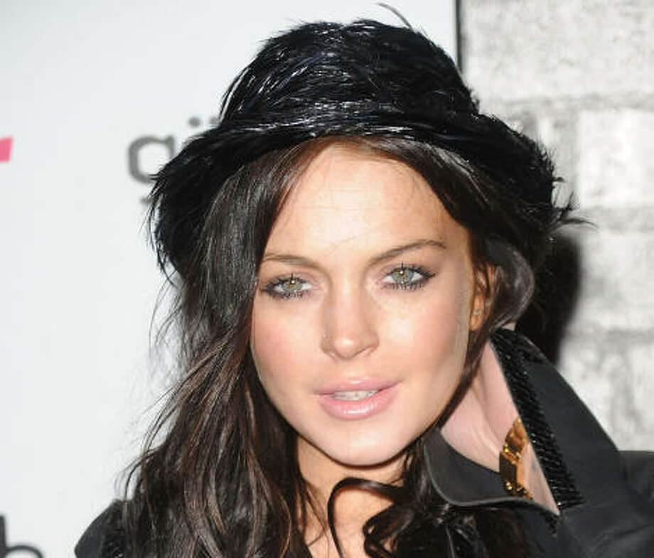 Lindsay Lohan sure gets a lot of publicity, but it's not usually good. Between her turbulent family life and non-existent career, it's amazing she still has time to party. But that's about all she's known for these days. So what do you think? Hot or not? Vote here. Photo: Jason Merritt, Getty Images
