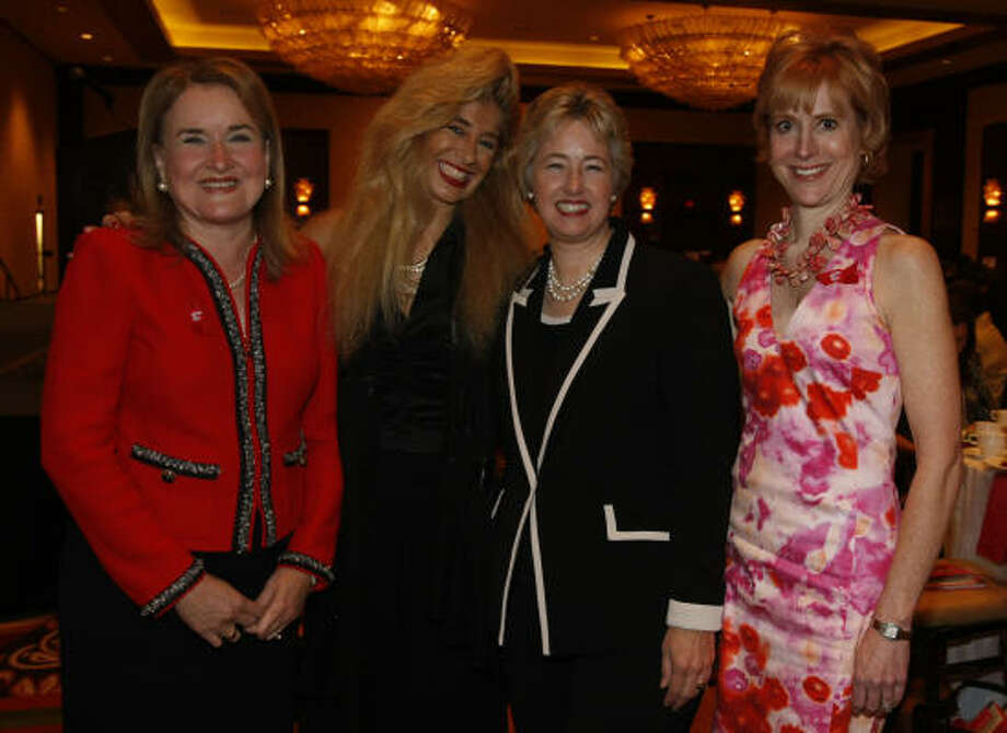 Commissioner Sylvia Garcia, from left, Sofia Adrogue', Mayor Annise Parker and Judge Caroline Baker Hurley at the Girls Inc. Strong, Smart and Bold Celebration Luncheon at the Hilton Americas. Photo: Julio Cortez, Chronicle