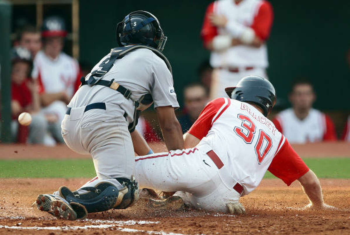 Rice catcher Diego Seastrunk can't hold onto the ball as Houston's Austin Gracey scores on a sacrifice bunt in the second inning.