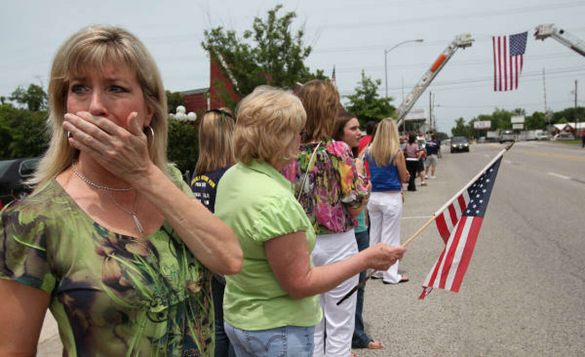 Evelyn Bird weeps while she waits along Main St. as the community welcome home the remains of USMC Cpl. Jeffrey Johnson in downtown Tomball , Cpl. Johnson was killed in Afghanistan.