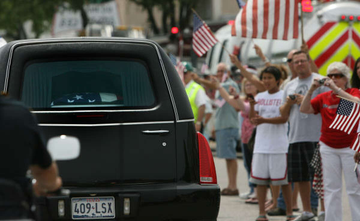The remains of USMC Cpl. Jeffrey Johnson arrive to Hooks Airport where the procession will go through downtown Tomball and ended at Klein Funeral Home in Tomball. Cpl. Johnson was killed in Afghanistan.