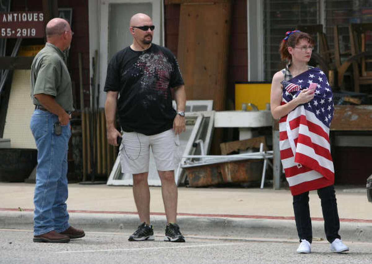 (right) Deana Willis and other members of the community wait to welcome home the remains of USMC Cpl. Jeffrey Johnson in downtown Tomball during a procession starting from Hooks Airport to Klein Funeral Home in Tomball. Cpl. Johnson was killed in Afghanistan.
