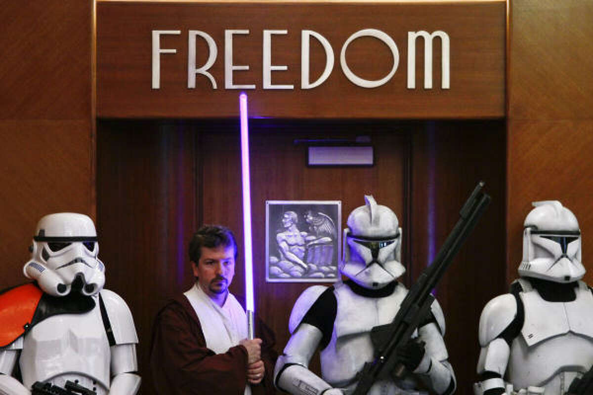 Members of the 501st Legion, an international group of Star Wars fans who own and wear realistic costumes from the Star Wars saga, wait in the City Council chamber before Mayor Annise Parker declared Tuesday,