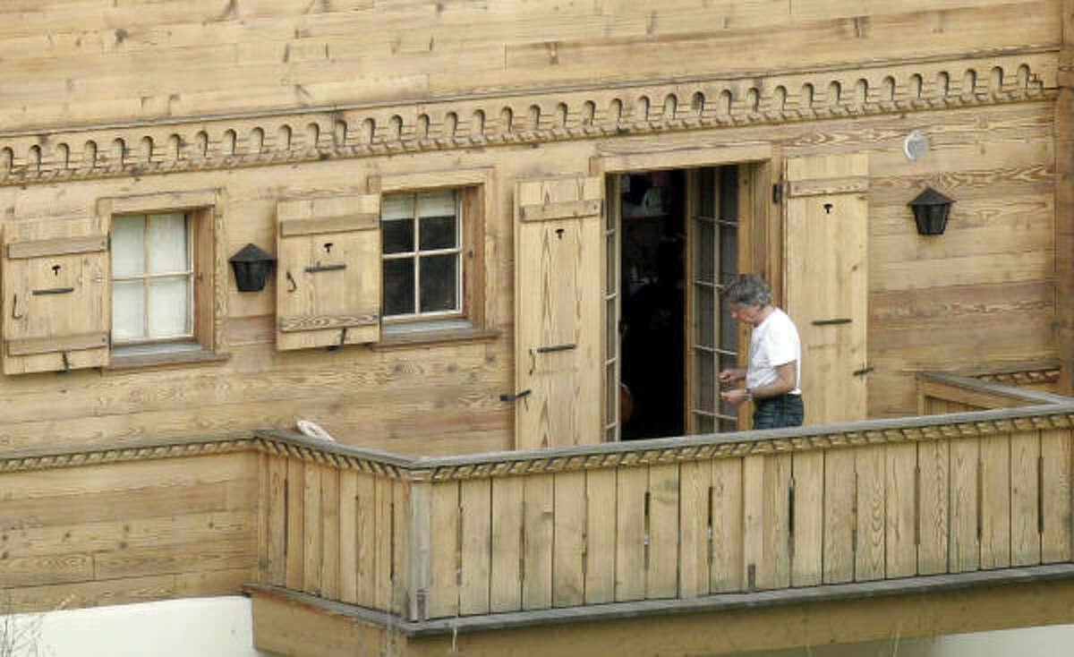 Roman Polanski is seen on the balcony of
