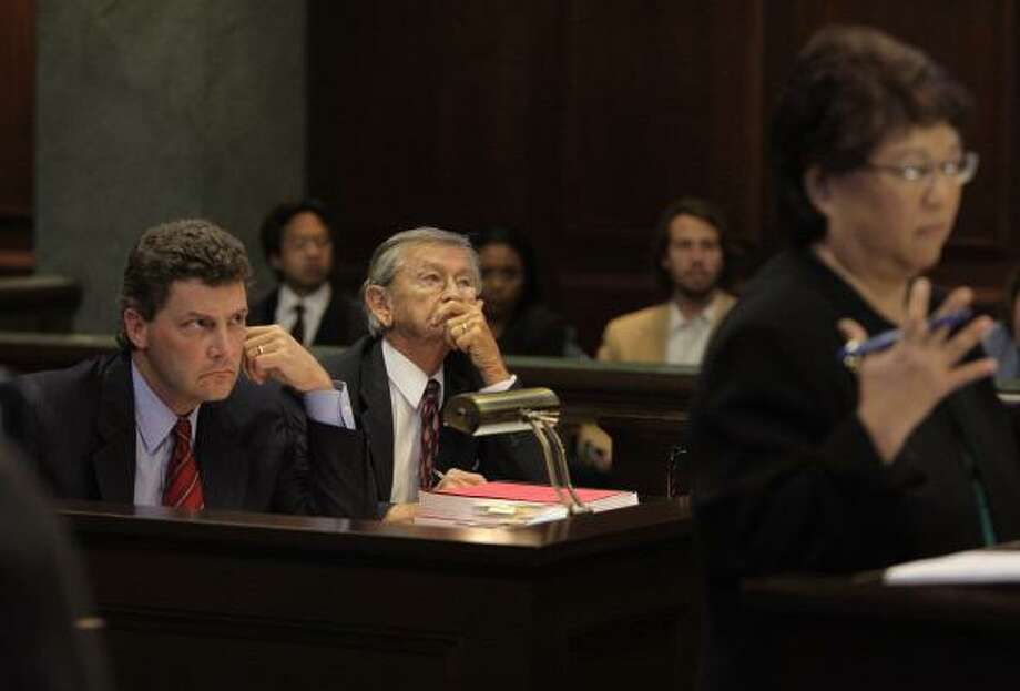 Chad Hummel, left, and Douglas Dalton, attorneys for Oscar-winning filmmaker Roman Polanski, listen as Deputy District Attorney Phyllis Asayama, foreground right, speaks during a hearing at the California Second District Court of Appeal in in Dec. 2009. Photo: Jae C. Hong, AP