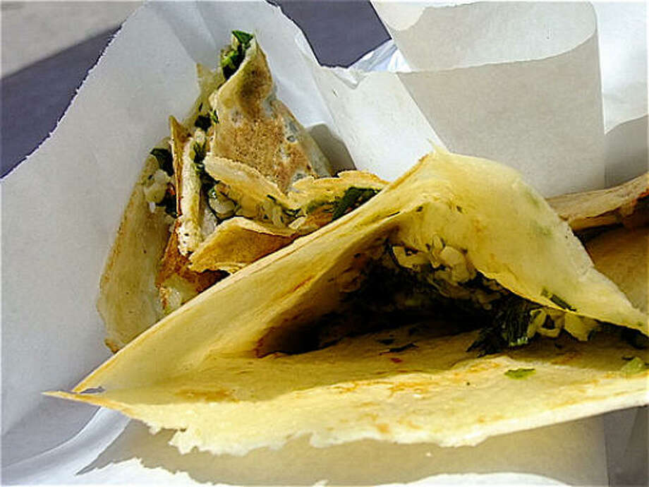 The very crisp edges of the tabouli & avocado crepe, Melange Creperie stand Photo: Alison Cook, Chronicle