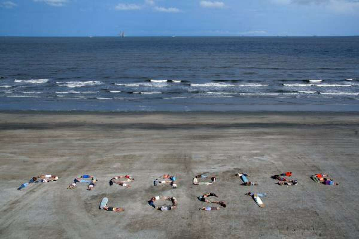 Demonstrators with the Commercial Fisherman of America and Global Green USA spell the words