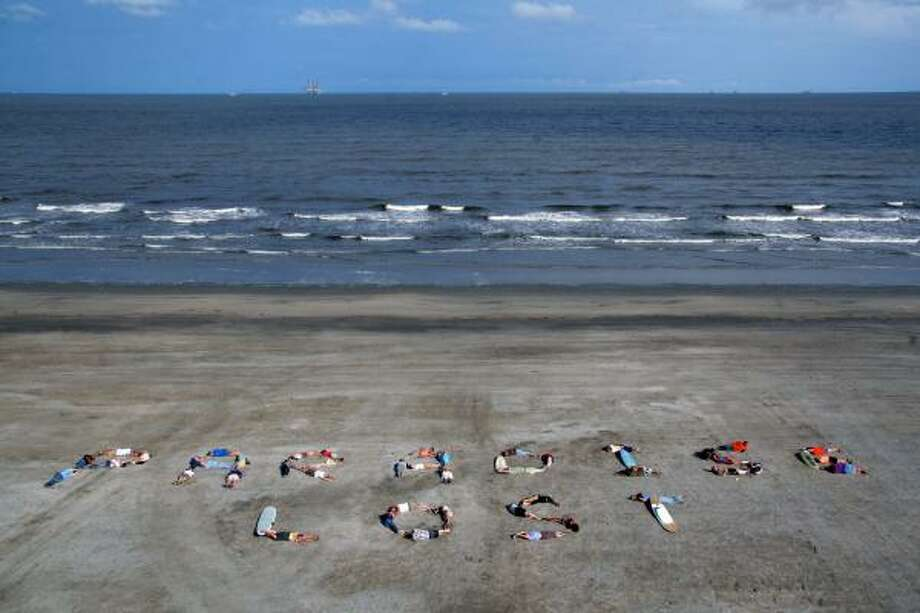 "Demonstrators with the Commercial Fisherman of America and Global Green USA spell the words ""Paradise Lost""  in Grand Isle, La., on May 16 in an attempt to send a message to BP and the Obama administration about devastation from the massive oil spill in the Gulf of Mexico. Photo: AP"