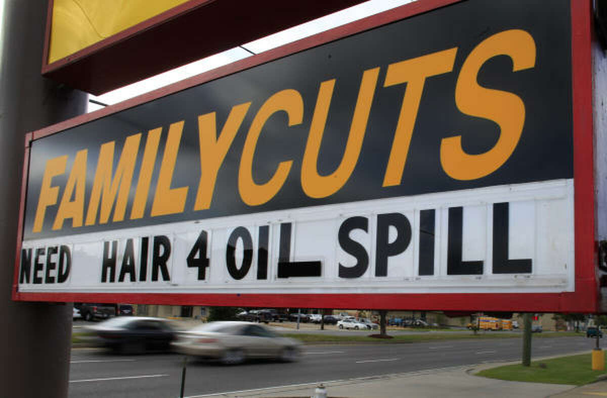 A sign calls for hair to be donated for Gulf cleanup efforts at a salon in Kenner, La., on May 16. The hair is collected to make oil-absorbing booms.