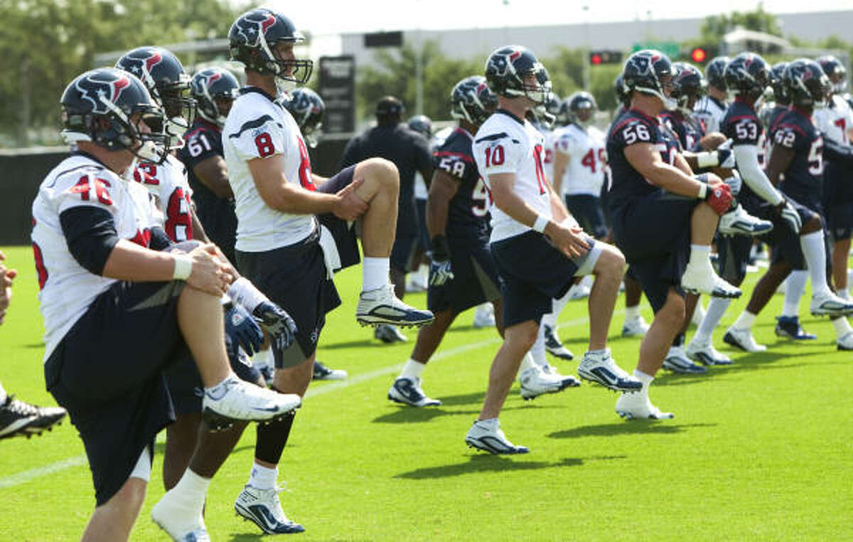 Texans players, including quarterback Matt Schaub (8), reported Monday for the first of 14 voluntary organized team activities at Reliant Park.