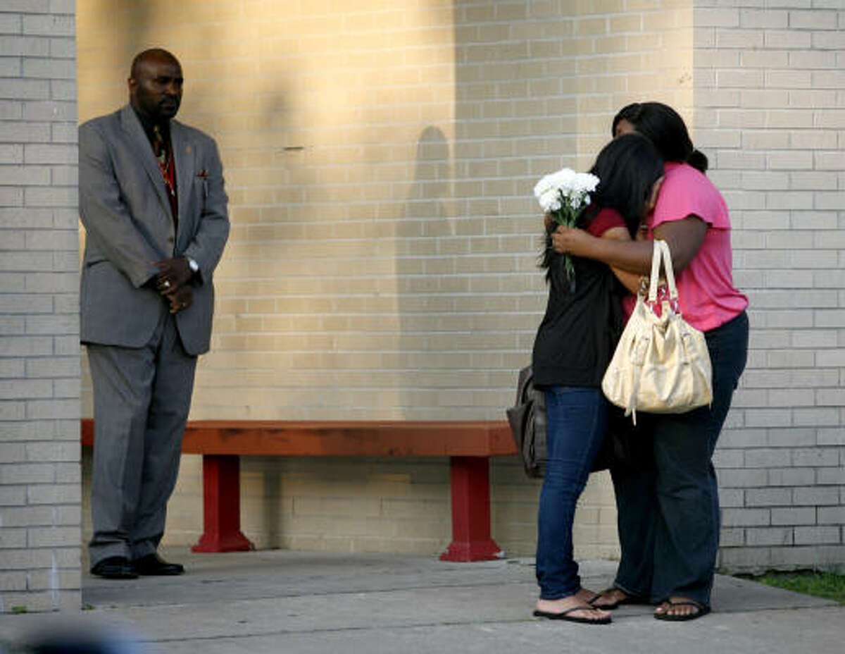 Bellaire High School students stop and hug on the sidewalk as they walk to class, Monday, May 17, 2010, a day after Bellaire High School basketball standout Tobi Oyedeji died in a car accident early Sunday morning.