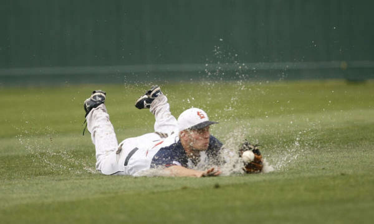 Seven Lakes right fielder Brad Snowden is unable to trap a fly ball hit by Bellaire's Aaron Hafer in the second inning. Hafer later scored on a double by Sean Washington as Bellaire took a 1-0 lead.